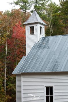 Beside the gorgeous mountain views from the valley of Cades Cove, there are also beautiful historic buildings to explore. This Missionary Baptist Church had more architectural features, with the steeple rising out of the smaller entryway and an apse behind the pulpit. The rain constantly falling gave a nice reflective surface on the roof and bolstered the saturation of the fall color behind.