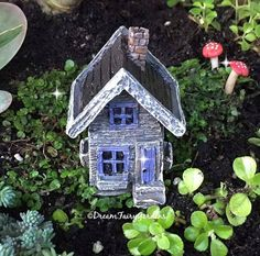 In the woods lies the entrance to this tiny charming micro mini fairy house. It has amazing detail to be so tiny! There are even little window boxes. Door does not open. Listing is for house only. Dimensions: 2.25″T x 1.5″ W x 1.5″ D  Fairy Gardens come in all sizes. Some are big and some are quite small. Be sure to check the measurements on this item to see if it will complement your garden or mini project. This item is not handmade by Dream Fairy Gardens but was thoughtfully selected as a…