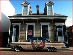 Big car or small house?... obviously no garage!