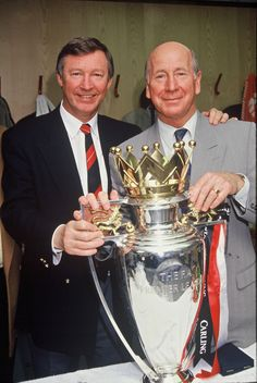 Two @manutd legends – Sir Alex Ferguson and Sir Bobby Charlton – pose with the club's first league title in 26 years back in 1993.