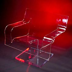 """CLEAR CONCENTRATION CHAIR     Materials: Clear acrylic  Dimensions: 37""""W x 21""""D x 32""""H (18"""" seat height, 1/2"""" thick acrylic, 2"""" thick base)    Options: Clear, color, or frosted acrylic / Swivel or stationary base"""