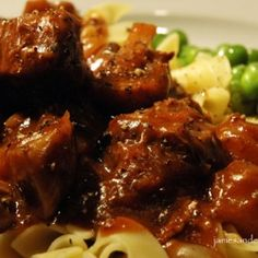 Beef Bourguignon - Pieces of beef, slowly simmered in an aromatic mix of beef stock, burgundy wine, carrots, pearl onions, and mushrooms