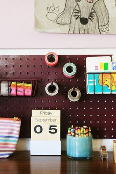 Homework Station in the Playroom (NOTE: pegboard accessories -- baskets, etc.) from Home Depot)