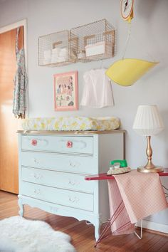 {Handmade Nursery « Spearmint Baby} Love the girly dresser as a changing table and the baskets mounted on the wall for storage. Diaper Storage, Basket Storage, Basket Shelves, Wall Storage, Nursery Storage, Nursery Organization, Storage Ideas, Wall Shelves, Diy Shelving