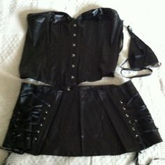 Faux Soft Black Leather Gothic Corset Skirt Set  Faux Leather Black Gothic Bustier Waist Trainer Gothic Corset Plus Size. This set has a corset, zipper skirt and g-string. See size chart. 5XL is shown to fit a 39-40 waist, size 18/20, 49-50 hips. 90% polyester 10% spandex. Strong Front Steel hook and stud closure. Ribbon fully lace up back for a custom fit. The inside is super soft! Perfect for brides, posture help, waist train, honeymoon or sexy time. Super soft like kid leather. All…