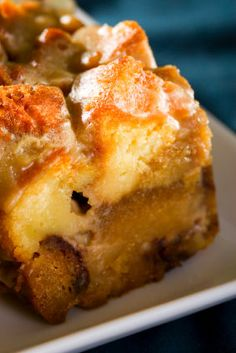 "Bread Pudding w/Vanilla Creme Sauce      2 T light brown sugar      3/4 c + 1 T  sugar      1 loaf challah bread, cut into 3/4"" cubes      9 lg egg yolks      4 t vanilla extract      2 t cinnamon      3/4 t salt      2 1/2 c heavy cream      2 1/2 c milk      2 T butter, melted    Vanilla Sauce        2/3 c sugar      4 T cornstarch      1/2 t salt      3 1/3 c cold water      6 T butter      4 t vanilla extract  1/2 t nutmeg..."