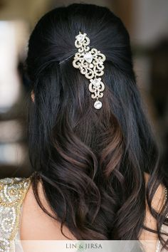Loose wavy hairdo with a simple, stoned brooch or large chandelier earrings with bobby pins  - perfect for your bridesmaids.     Courtesy Lin and Jirsa Photography | for more inspiration visit www.shaadibelles.com