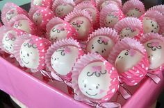 Girl or boy baby shower idea.  Cake pops lightly decorated, place girl/boy color cupcake papers around and tie with a bow.  So cute, and very clever!