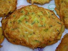 Zucchini Hashbrowns    2 medium eggs  1 tsp garlic powder  1 tsp onion powder  1 dash pepper  1 dash salt  1 tbsp olive oil  1 cup shredded zucchini  Directions    Heat oil in skillet.  Mix together zucchini, slightly beaten eggs, salt, pepper, garlic powder and onion powder.  Drop by spoonfuls into the hot skillet.  After browning on one side flip and brown the other side.