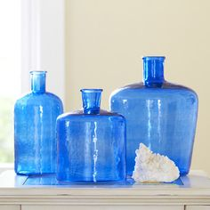 Glass Bottle Vase, Blue- thought the one I bought was antique or at least vintage, turns out you can get them in bulk at a local wholesale craft supply store.  Still, I like it and it fits my decor an I don't need to worry about breaking it on accident since it's so easily replaceable.