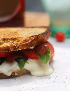 Caprese BLTs - Gooey cheese, fresh tomatoes and garlicky aioli on perfectly crisp bread!