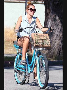Miley Cyrus takes a  leisurely ride around Los Angeles's Toluca Lake neighborhood.