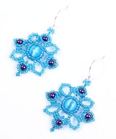 """Exquisite craftsmanship evokes natural flowery design with aqua blue seed beads, baby blue cat's eye glass and purple Swarovski pearls. Silver mental. Handmade in USA.  Length: 2 1/8""""  No shipping cost for all the items in the store."""