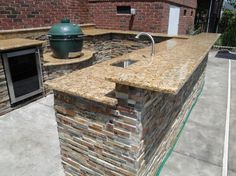 Dazzling U-shaped Outdoor Kitchen Designs With Sunset Gold Granite Kitchen Countertop And Split Level Breakfast Bar Also Big Green Egg Outdoor Kitchen Grills