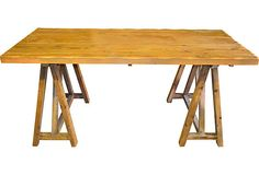 Rustic desk made of reclaimed barn wood on a double trestle base. American rural.