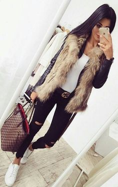 #winter #fashion /  Black Leather Jacket / Faux Fur Vest / Black Destroyed Jeans / White Sneakers Fur Vest Outfits, Chic Outfits, Cooler Look, Winter Fashion Outfits, Autumn Winter Fashion, Winter Outfits, White Fur Vest, Faux Fur Vests, Lv Bags