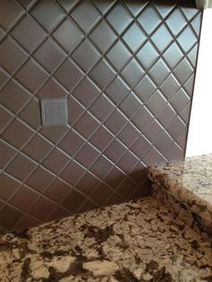diagonal chocolate 2x2 w/ pewter resin accents kitchen backsplash in Port Richey, Florida #tile #diagonal #backsplash #ceramictec
