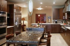 Contemporary Kitchen with European Cabinets, Teagan Cabinets, U-shaped, Complex granite counters, Kitchen island, flush light