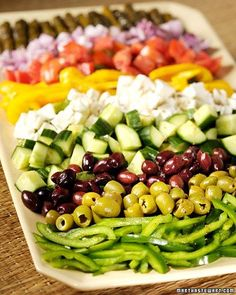 Greek Salad....i like that you have a variety of toppings for a salad but they are all organized on a platter rather than a million seperate dishes to clean afterward :)