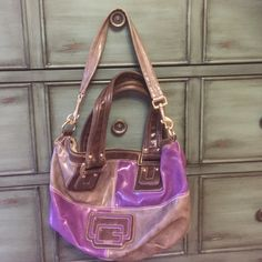 Purple and gray leather Guess bag  Leather colorblock hand bag with shoulder bag  strap. Lovely combo of purple, gray and brown with silver hardware and top zipper closure. Zippered pocket and 3 card slots inside. Lining in good condition. Some ink markings on leather as shown in 3rd pic but barely noticeable. Guess Bags Satchels