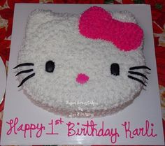 Hello Kitty - 1St Birthday Hello Kitty head is a 3 layer, chocolate cake with cream cheese filling, iced in buttercream with fondant...