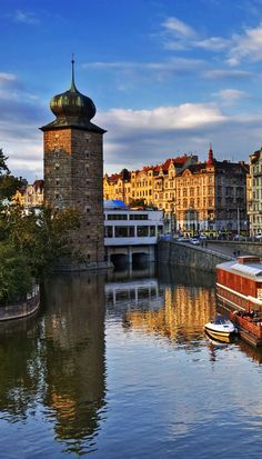 View of the riverside of Moldau/Vltava river in Prague near rasionovo nabrezi…