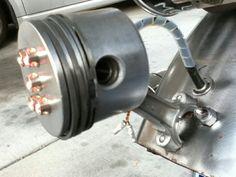 Piston tail light