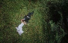 wedding photography bride groom laying in field photographed from above Matt Shumate Photography