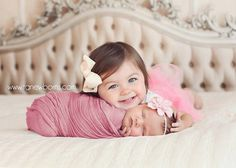 Cute picture, and love the cheesecloth wrap.
