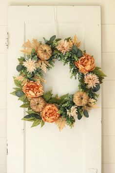 Fall Wreath ~ Fall Door Wreath ~ Fall Farmhouse Wreath ~ Autumn Wreath A beautiful fall pumpkin, coral peony, fall leaf, eucalyptus and spider mum wreath. This wreath features all of the rich color goodness of fall. It is all attached to a natural grapevine base. A beautiful indoor or outdoor