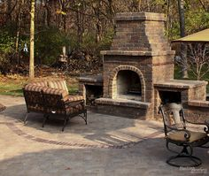 Brick fireplace and patio. Remodeling by Martin Bros. Contracting, Inc. Hardscaping by Stone Ridge Landscaping.