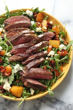 Arugula Skirt Steak Salad with Caramelized Pears, Pecans, and Gorgonzola - Hearty, flavorful, and healthy!