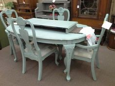 $325 -This is a large shabby chic dining table with an additional leaf and 4 matching chairs. Painted duck egg blue, distressed and finished with a dark wax. Chairs have a neutral, new upholstery. The table measures  42 inches  by 62 inches  with an 18 inch leaf . The set can be seen in booth E 5 at Main Street Antique Mall 7260 East Main St ( E of Power Rd ) Mesa 85207  480 9241122open 7 days 10 till 530 Cash or charge 30 day layaway also available