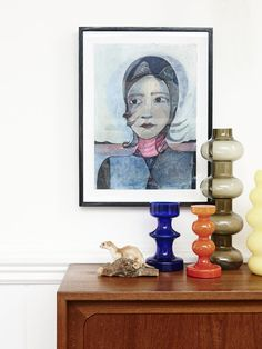 Living room details – various Holmegaard glass vases on sideboard, taxidermied stoat, Blue lady painting by Alexi Freeman. Production – Lucy...