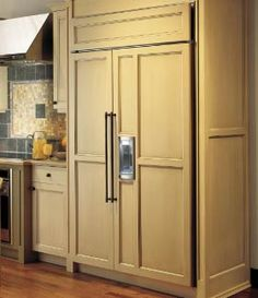 That fridge blends in with the rest of the kitchen. At first I thought it was a pantry door. I would love to have a sweet fridge like that in my kitchen someday.