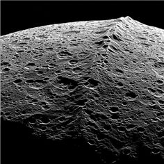 Iapetus – the black-and-white walnut Moon- Iapetus is the third largest moon of Saturn, This is the equatorial ridge that  runs along the center of Cassini Regio; in case you were wondering, the ridge has an average height of 13 km, occasionally going up to 20km, a length of 1,300 km and a width of about 20 km. It was discovered when the Cassini spacecraft imaged Iapetus on December 31, 2004, and even in 2013, it has astronomers baffled.