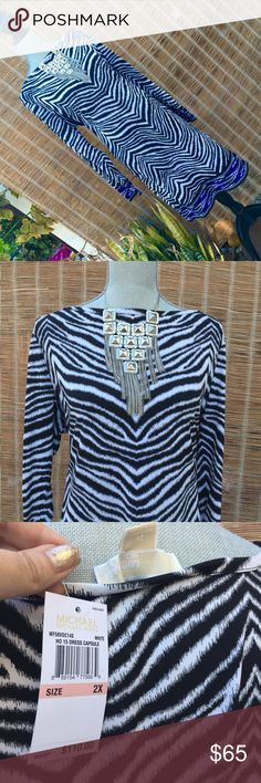 Host pick Michael Kors Plus Size Zebra Print Dress How hot is this Michael Kors Plus Size Zebra Print Dress? Black and white graphics with an accent of royal Blue on the sleeve and bottom-midi length is perfect for curvy gals-breath sheath dress Michael Kors Dresses Long Sleeve