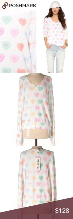 """Wildfox Sweet Heart V-neck Baggy Beach Jumper Wildfox Couture Sweet Heart V-Neck Baggy Beach Jumper is covered in conversational hearts of all the things we luv. Featuring adorable hearts that say, """" My Cat. Pizza. Sleepovers. Pina Colada. Shopping. Kissing"""" What more could you want from this adorable pastel heart colored top with a V-Neck. This loose fitting top is made from the coziest material ever.  Materials: 47% Rayon, 47% Polyester, 6% Spandex Machine Washable Wildfox Sweaters V-Necks"""