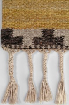 detail: carpet   flatweave   warm ochre colored wool + abstract black end pattern + fringe   Sweden   c. 1930