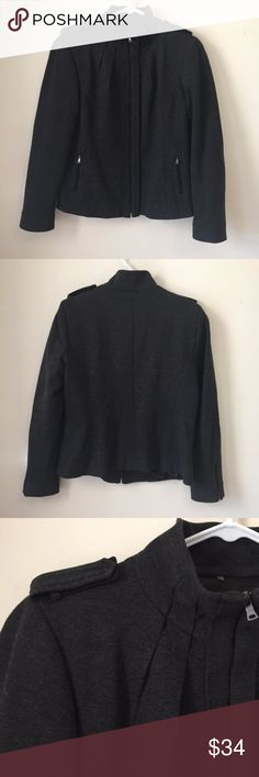 """Elie Tahari Grey Ponte Knit Zip Up Jacket Large Elie Tahari full zip jacket in dark grey heather. Features a standing collar with gathered pleats below, shoulder epaulets, two zip pockets, and zippered cuffs. Lined. Size Large. Excellent condition.  Approx. measurements: pit to pit ~20"""", shoulder to hem ~23.5"""". Elie Tahari Jackets & Coats"""