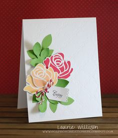 I do have to say how easy they were to cut out tho!  I layered them with the TANL die.  I cut out several and then cut them apart, rearranged them, turned them over, curled some of the leaves.  I love this look!  Then I added in those gorgeous roses!              All of this is on top of the card base where I used the Quatrefoil die to emboss the card front.  Super easy!  I added a Tiny Tag and a little Twinery twine and done!
