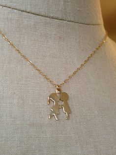 Boy and Girl Kiss Me Necklace by charlieandmarcelle on Etsy, $18.99