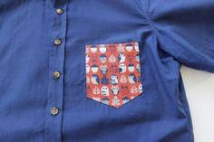Indigo dyed short-sleeve shirt with orange owl print contrast pocket by Kirrin Finch