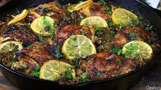 Juicy, crispy-skinned chicken thighs resting on a bed of lemony rice.