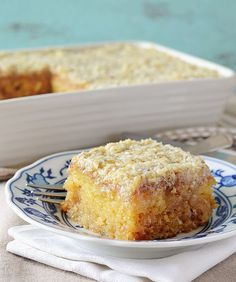 Do Nothing Cake, aka Texas Tornado Cake - ridiculously easy pineapple dump/poke cake with coconut walnut frosting; super moist and ideal for potlucks!