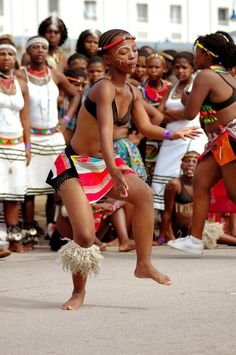 Photo about A female African dancer dancing and entertaining people outdoors. Image of bare, dance, dancing - 4945487