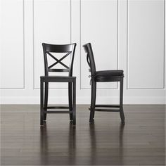 Shop Vintner Black Bar Stool and Cushion.   Add a layer of comfort by tying on a custom-fitted cotton cushion.  The Vintner Black Counter Stool is a Crate and Barrel exclusive.