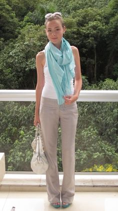 Beige relaxed fit pants, white tee and colored scarf with matching heels! Perfect Spring/Summer outfit