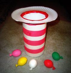 Cat in the Hat toss game Glue white construction paper to the outside of the oatmeal container. You can use small balls or beanbags for this Cat in the Hat toss. I made some homemade balloon balls by putting Moon Dough into balloons.re squishy, Dr. Seuss, Dr Seuss Week, Dr Seuss Crafts, Preschool Crafts, Crafts For Kids, Preschool Ideas, Family Crafts, Teaching Ideas, Preschool Songs
