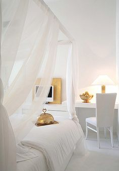 white | four poster bed + canopy of flowing white sheets + hint of gold BUT not great if you have pets i'm guessing.